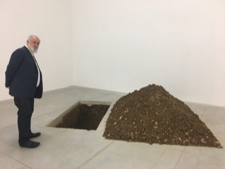 Massimo de Carlo in front of 'Grave' by M Cattelan