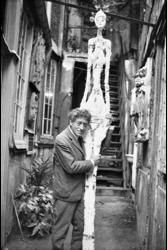 Alberto Giacometti in the yard of the studio with la Grande femme IV by Annette Giacometti